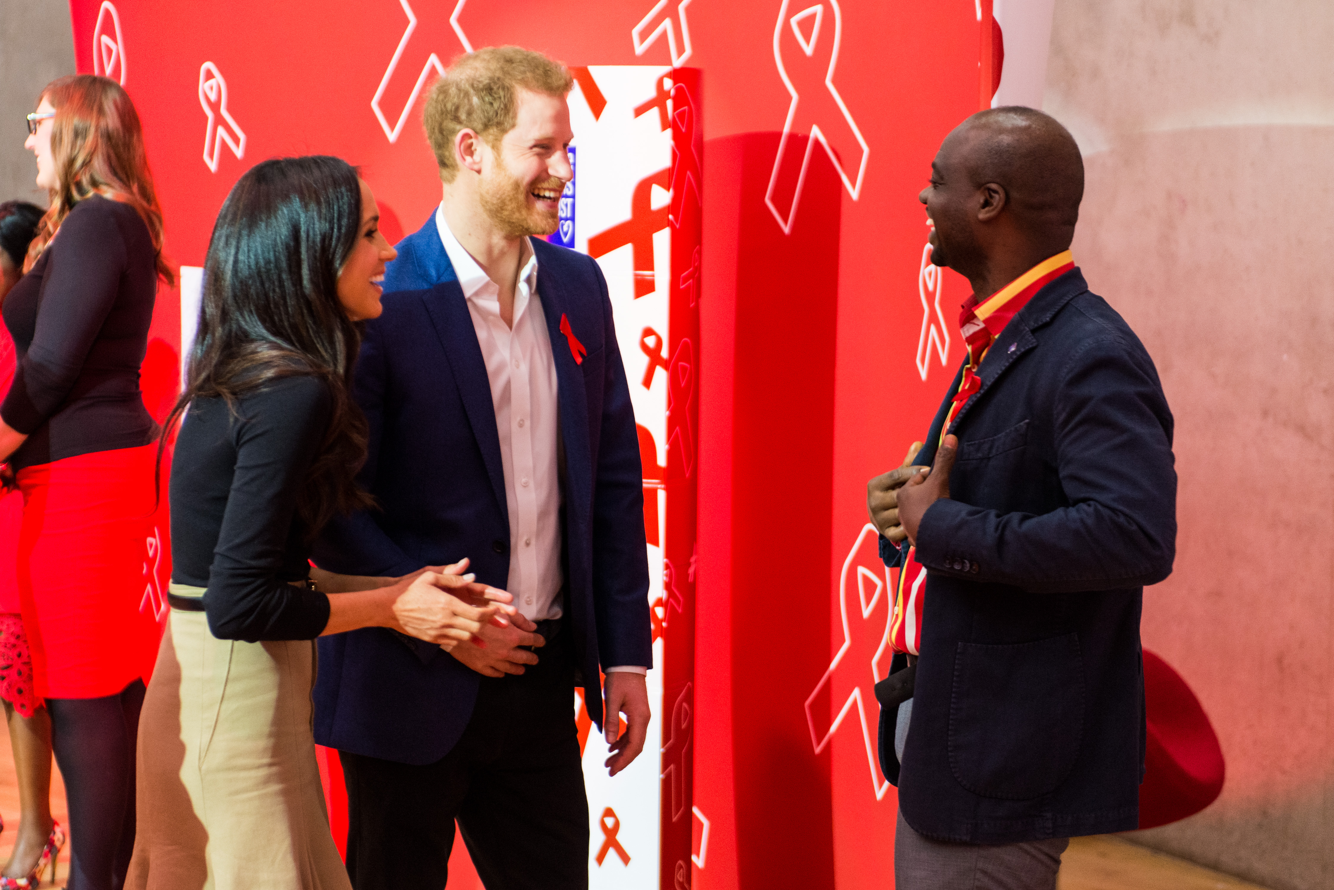 Ms Markle and Prince Harry talking about HIV