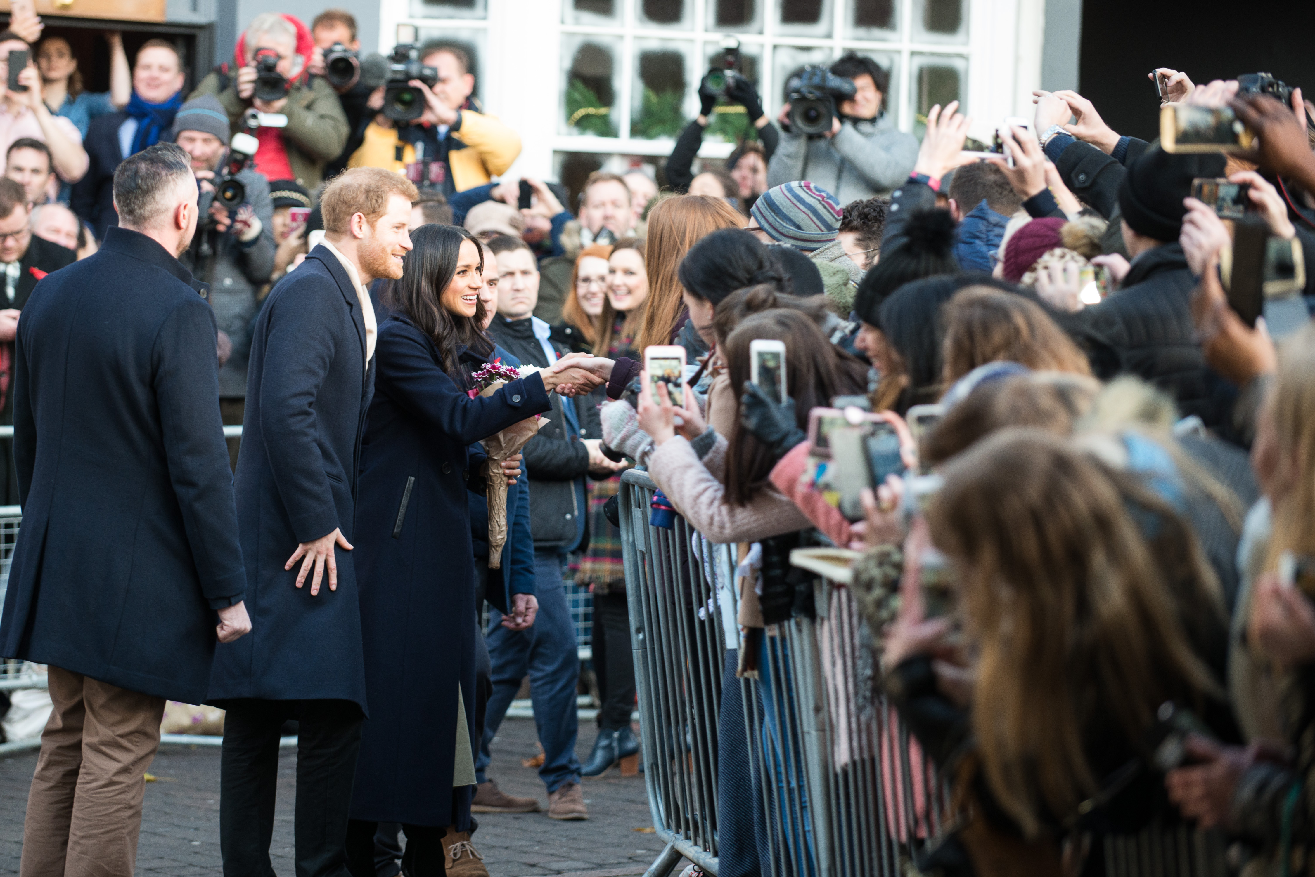 Prince Harry and Meghan Markle meeting onlookers in Nottingham
