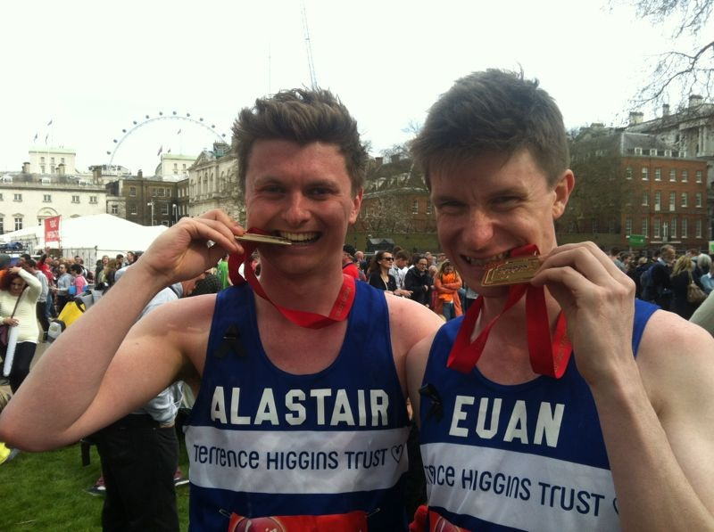 Runners with medals at London Marathon