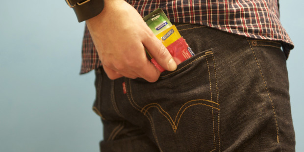 Man putting condoms in back pocket