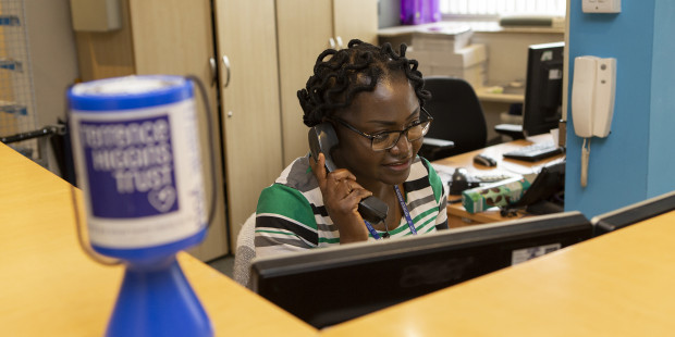 Volunteer on the phone in Terrence Higgins Trust reception