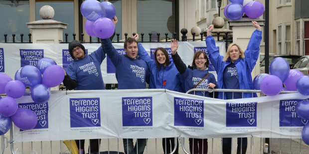 Terrence Higgins Trust staff and volunteers at an event cheerpoint