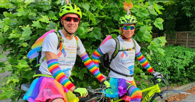 Cyclists in rainbow gear