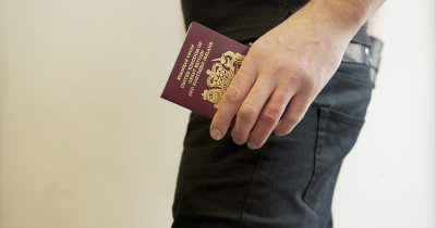 Man holding UK passport