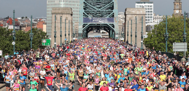 Great North Run runners on bridge