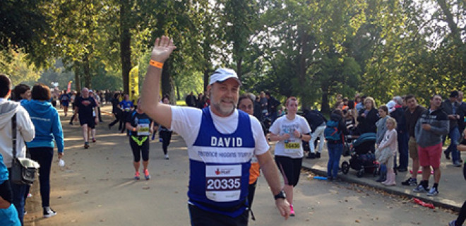 Runner David waving at the Royal Parks Foundation Half Marathon