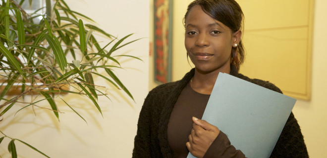 Woman holding a document file