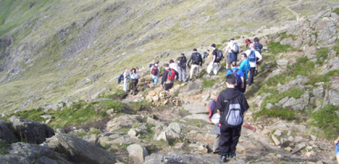 Line of people descending Snowdon