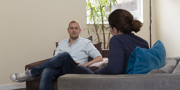 Two people talking in a counselling room