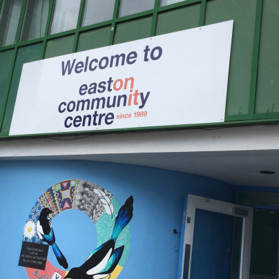 """Welcome to easton community centre"" sign over door"