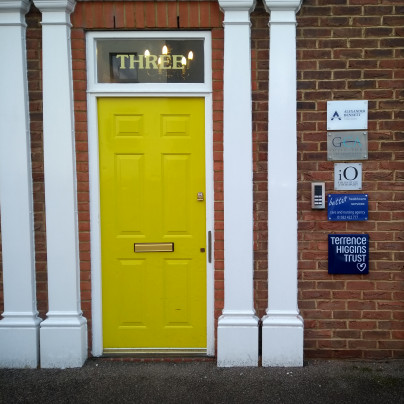 Terrence Higgins Trust Luton office front door, yellow