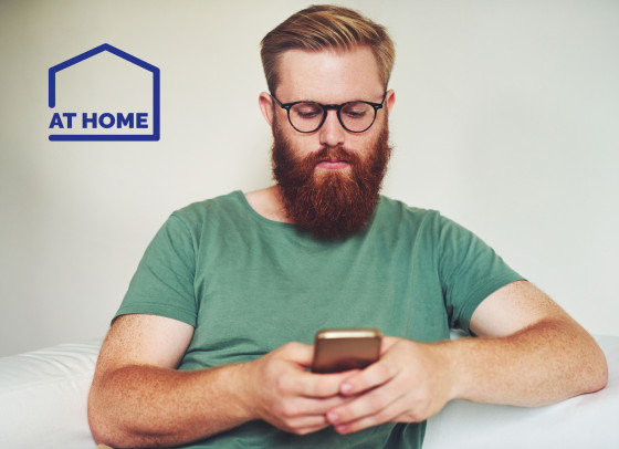 Man using his mobile phone - At Home