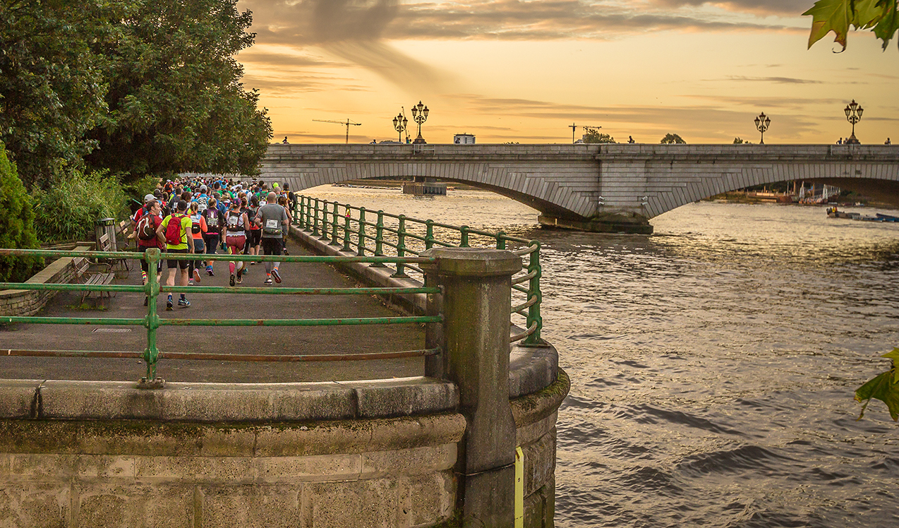 Thames Path Challenge bridge sunset with walkers
